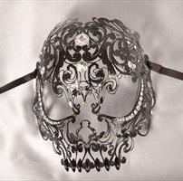 Filigree metal skull mask.