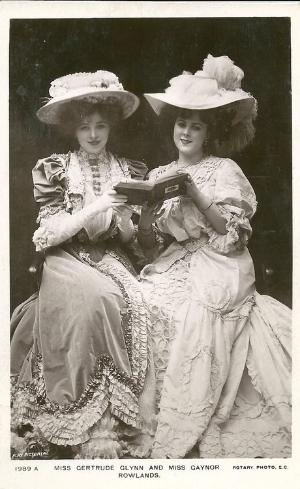 B&W Two young Edwardian women share a book.