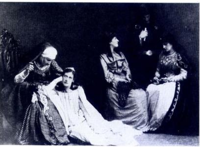 B&W Three women and a man in Orientalist costume on stage, early C20th.
