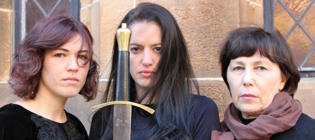 Three brunette women of varying ages, with sword hilt.