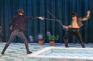 Two young men duelling with rapiers.